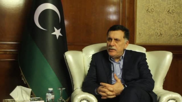 vídeos de stock, filmes e b-roll de the head of libya's unbacked government fayez alsarraj urges the international community to find a common vision for the chaoshit north african... - líbia