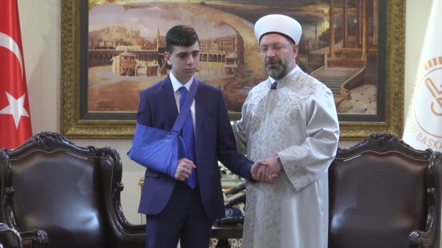 The head of Turkey's Religious Affairs Directorate Ali Erbas received Fawzi alJuneidi the teenager who became a symbol of Palestinian opposition to...