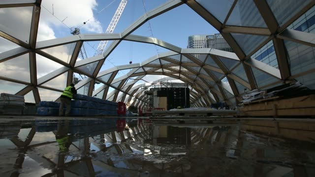 the headquarters of hsbc holdings plc are seen through the unfinished roof structure of the canary wharf crossrail station during construction in... - bank of america stock videos & royalty-free footage