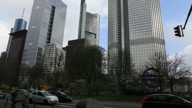 the headquarters of the european central bank right stands beside the headquarters of commerzbank ag left in frankfurt germany on monday march 24... - ヘッセン州点の映像素材/bロール