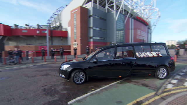 the hearse carrying nobby stiles driving past old trafford - gesturing stock videos & royalty-free footage