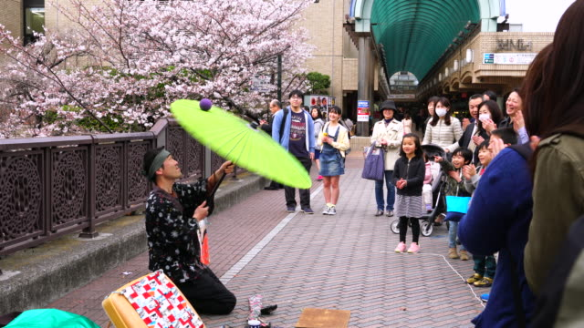 the heaven artist who is passed the examination committee of tokyo government the heaven artists show a performance and music in public facilities or... - street performer stock videos & royalty-free footage