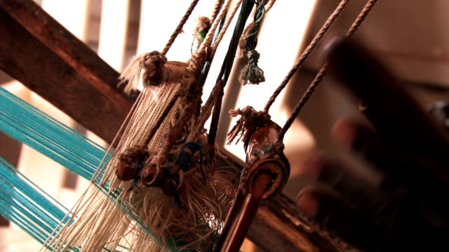the heddles in motion on an african hand-loom - ghana stock videos and b-roll footage