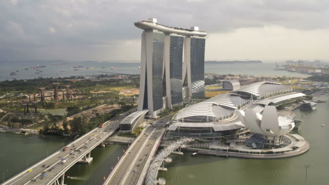 the helix bridge and marina bay sands singapore. marina bay, singapore - steel stock videos & royalty-free footage