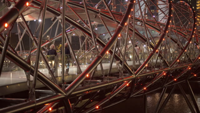 the helix bridge - pedestrian stock videos & royalty-free footage