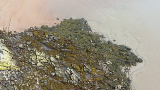 the high angle view of low tide on a beach in dumfries and galloway, south west scotland - low tide stock videos & royalty-free footage