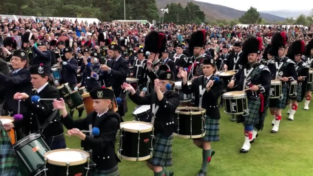 the highland games begin at the princess royal and duke of fife memorial park braemar the gathering has been run in its present form since 1832 - highland games stock videos & royalty-free footage