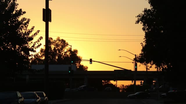 the highway at sunset, bakersfield, california, usa. - orange colour stock videos & royalty-free footage
