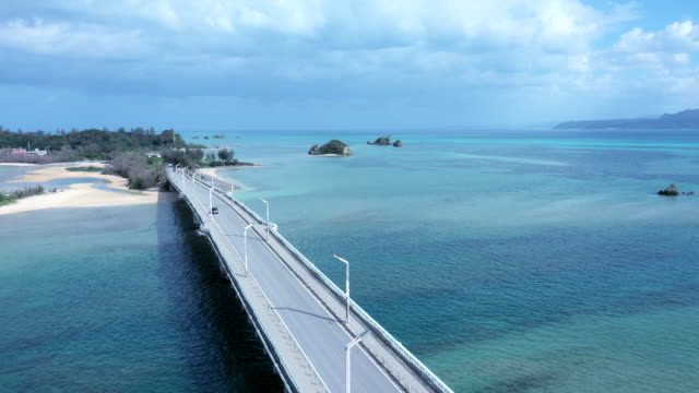 the highway over beautiful sea - okinawa prefecture stock videos & royalty-free footage