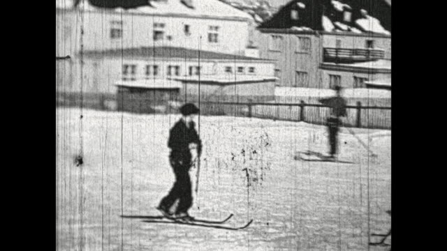the hill mühlberg in the vogtland saxony people having fun in the snow at the ski piste men skiing kids sledding little ski jump where the men try... - nordic skiing event stock videos and b-roll footage