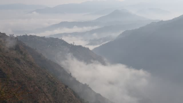 WS TU of the hillside in the mountains near Kathmandu Nepal that is covered with clouds