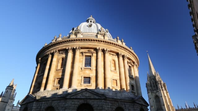 the historic radcliffe camera building in oxford uk which houses an ancient library - pinnacle stock videos & royalty-free footage