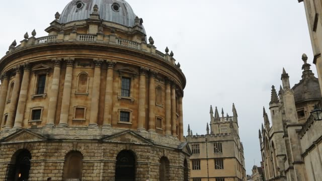 the historic radcliffe camera building in oxford, uk, which houses an ancient library. - radcliffe camera stock videos and b-roll footage