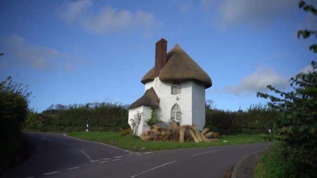 the historic toll house at stanton drew, somerset, uk. - strohdach stock-videos und b-roll-filmmaterial