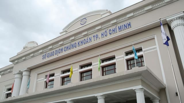 the ho chi minh stock exchange in ho chi minh city vietnam on monday june 2 laborers work near a sign for the ho chi minh stock exchange in ho chi... - vietnam meridionale video stock e b–roll