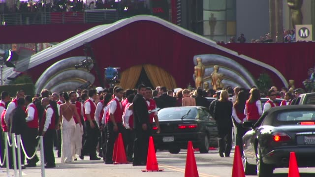 the hollywood boulevard entrance to the academy awards with guests arriving in limos and fine automobiles, greeted by security, police, the press and... - academy awards stock videos & royalty-free footage