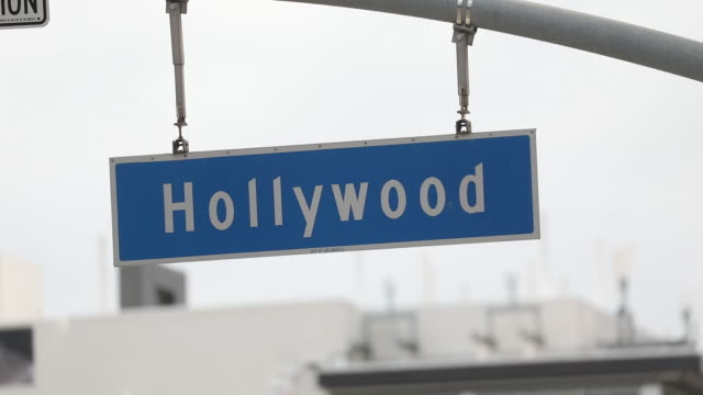 the hollywood boulevard street sign in los angeles, california, u.s., on thursday, april 2, 2020. the u.s. west coast is offering hopeful signs that... - hollywood boulevard stock videos & royalty-free footage