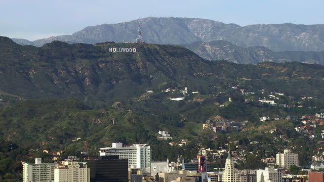 the hollywood sign, a famous los angeles landmark, amidst a scenic hollywood landscape. - western script stock videos & royalty-free footage