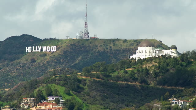 ws t/l the hollywood sign and griffith observatory with clouds / los angeles, california, usa - hollywood california stock videos & royalty-free footage