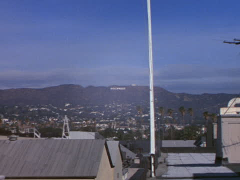 the hollywood sign sits in the hillside behind paramount studios. - paramount pictures stock videos & royalty-free footage