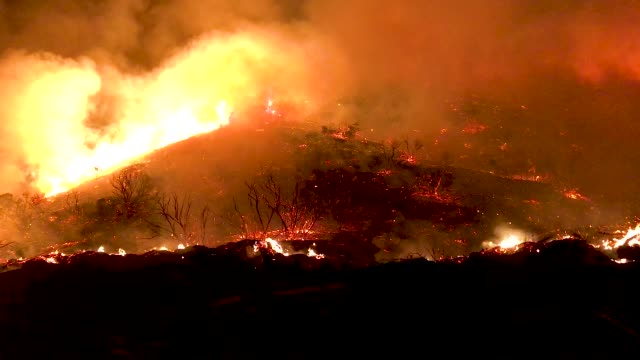 The Holy Fire burns near homes on August 9 2018 in Lake Elsinore California