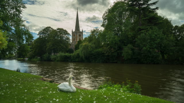 the holy trinity church in stratford-upon-avon, warwickshire, west midlands - 4k time-lapse - barge stock videos & royalty-free footage