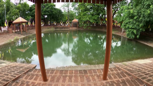 the holy water pool of wat pho kao ton temple - holy water stock videos & royalty-free footage