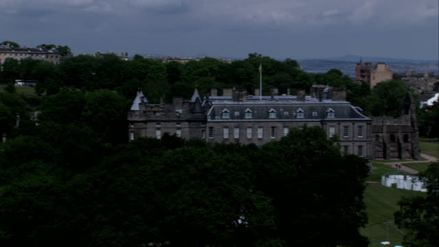 the holyrood palace stands at the bottom of the royal mile in edinburgh scotland. available in hd. - royal stock videos and b-roll footage