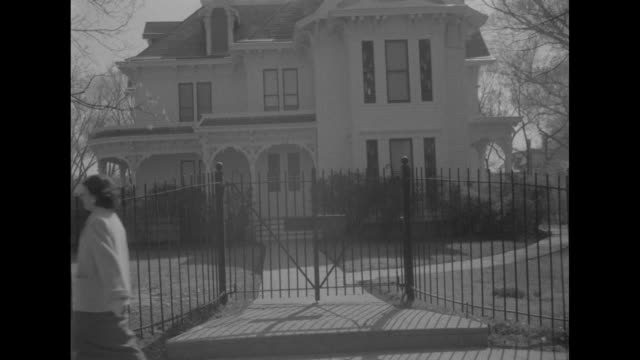 stockvideo's en b-roll-footage met ls the home of former us president harry truman as seen from across the intersection with street signs in foreground / montage ws side views of house... - margaret truman