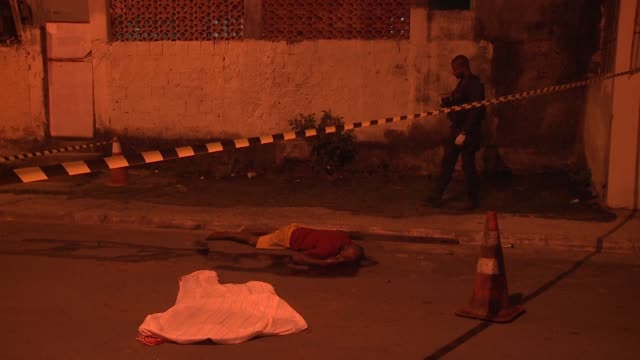 the homicide squad visits a crime scene in baixada fluminense, rio de janeiro. the murder victim died in the suburbs of rio late august 2017. - gory of dead people stock videos & royalty-free footage
