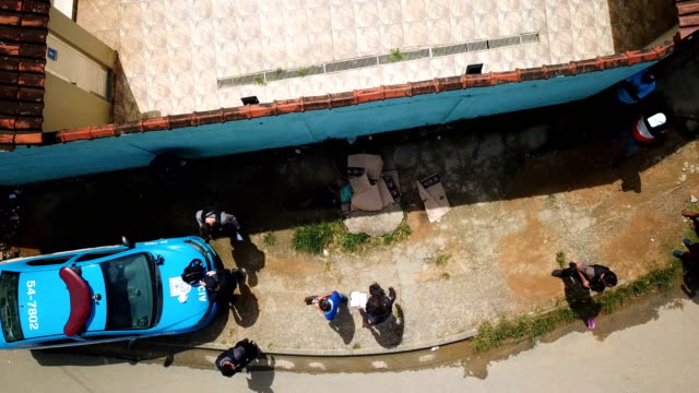 the homicide squad visits a crime scene in baixada fluminense rio de janeiro the murder victim died in the suburbs of rio late july 2017 - murder victim stock videos & royalty-free footage