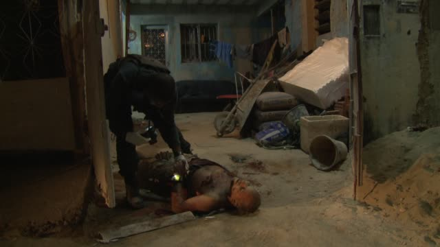 the homicide squad visits a crime scene in baixada fluminense rio de janeiro the murder victim died in the suburbs of rio late july 2017 - criminal investigation stock videos & royalty-free footage