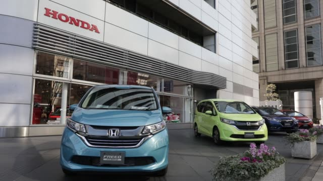 the honda motor co logo is displayed at one of the company's showrooms in tokyo japan on wednesday feb 1 pedestrians walk past a honda motor co freed... - spada stock videos & royalty-free footage