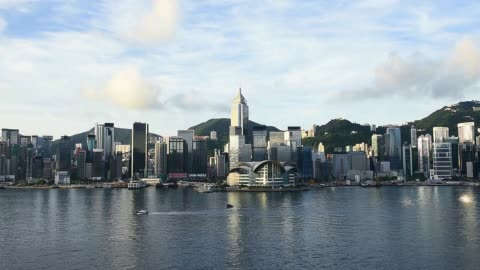the hong kong convention and exhibition centre, center bottom, and other commercial and residential buildings standing on hong kong island are seen... - hong kong island stock videos & royalty-free footage