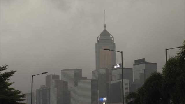 the hong kong observation wheel, left, stands in the central district of hong kong during a no. 10 hurricane signal raised for typhoon hato in hong... - central plaza hong kong stock videos & royalty-free footage