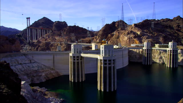 the hoover dam hydroelectric power generating station stands in the black canyon in nevada. - black canyon stock videos & royalty-free footage