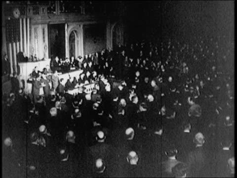 vídeos de stock, filmes e b-roll de the house of representatives votes to declare war / house members applaud - 1941