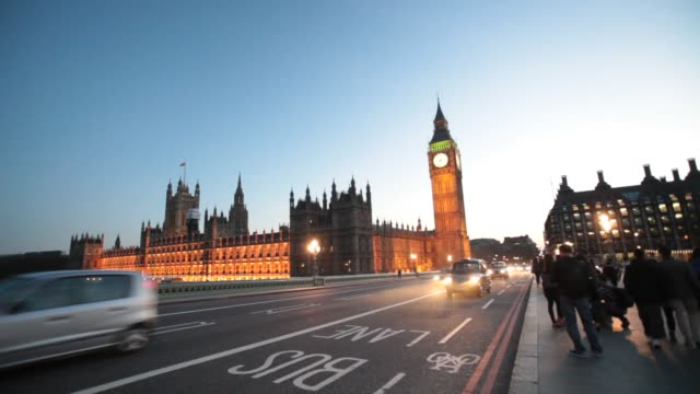 the houses of parliament and big ben from westminster bridge, london, uk. - politics icon stock videos & royalty-free footage