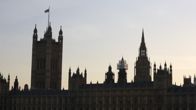 the houses of parliament and big ben in london, uk, at sunset. - back lit stock videos & royalty-free footage