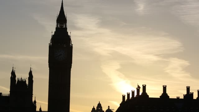 the houses of parliament and big ben in london, uk, at sunset. - silhouette stock videos & royalty-free footage