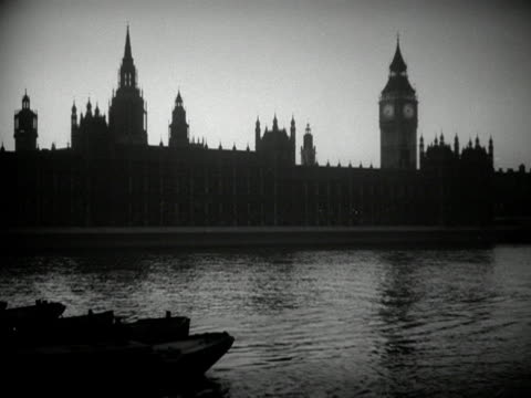 the houses of parliament are silhouetted at dusk. - houses of parliament london stock videos & royalty-free footage