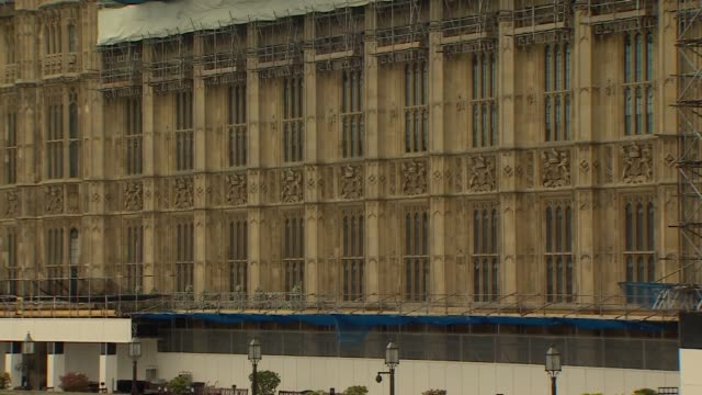 the houses of parliament from across westminster bridge on a rainy day - general view stock videos & royalty-free footage
