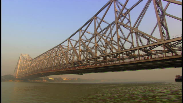 the howrah bridge at dusk - howrah bridge stock videos & royalty-free footage