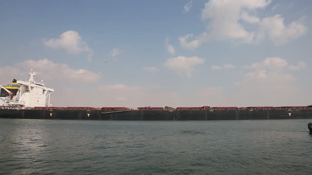 the huahine bulk carrier moving across the suez canal after the dislodging of the giant ever given container ship cleared the key trade route for... - suez canal stock videos & royalty-free footage