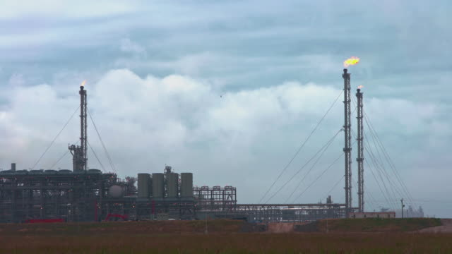 the huge refinery at the border between louisiana and texas, usa. accelerated timelapse-style video. - motor oil stock videos & royalty-free footage
