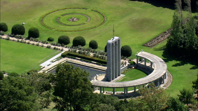 the huguenot monument  - aerial view - western cape,  cape winelands district municipality,  stellenbosch,  south africa - franschhoek stock videos and b-roll footage