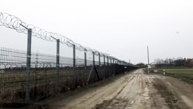 the hungarian border fence with serbia on january 18 2019 outside szeged hungary in 2015 thousands of migrants massed on the hungarian border the... - 2010 2019 stock videos & royalty-free footage