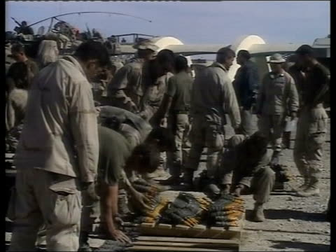 the hunt of mullah mohammed omar; lib afghanistan: kandahar ext gv us marines preparing weapons on ground soldier dusting weapon gvs troops laying... - us military stock videos & royalty-free footage