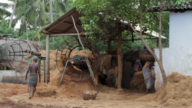 the husking machine is used to turn coconut fibers into rope - husking stock videos & royalty-free footage