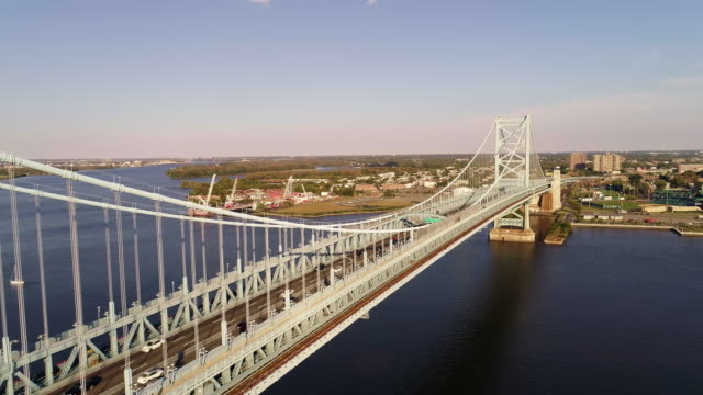 The hyper-lapse. Drone aerial view over the Benjamin Franklin Bridge across the Delaware River from Philadelphia, PA to Cadmen, NJ